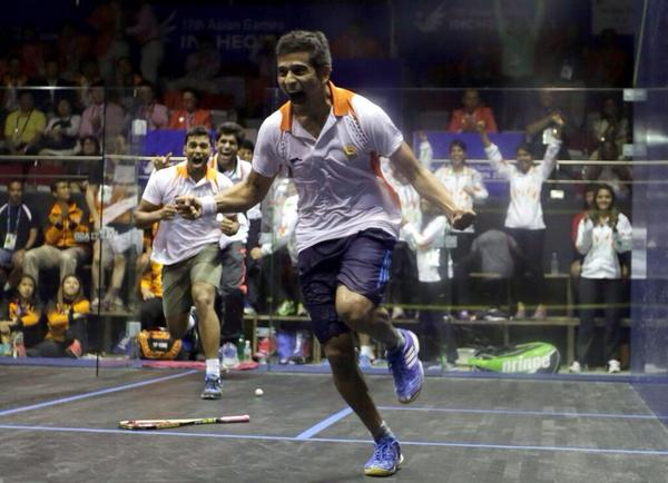 Saurav Ghosal celebrates India's team gold at the Asian Games