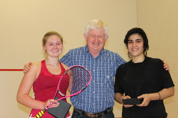 Hollie Naughton, left, is pictured with runner-up Maria Toorpakai Wazir and tournament sponsor Doug Ramsay