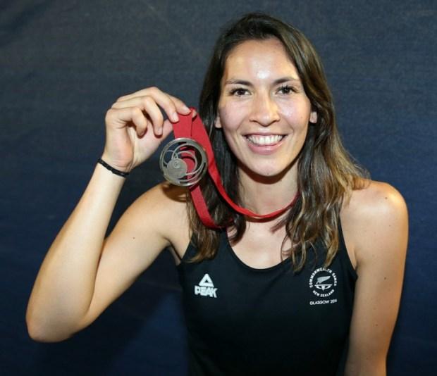 Joelle King celebrates her bronze medal in Glasgow