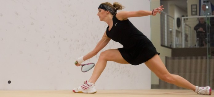 Sarah Kippax stretches for a shot against Anna Kimberley