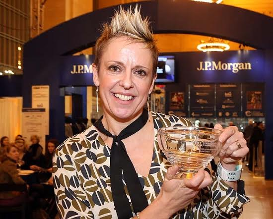 Heights Casino squash director Linda Elriani with her award at theToC