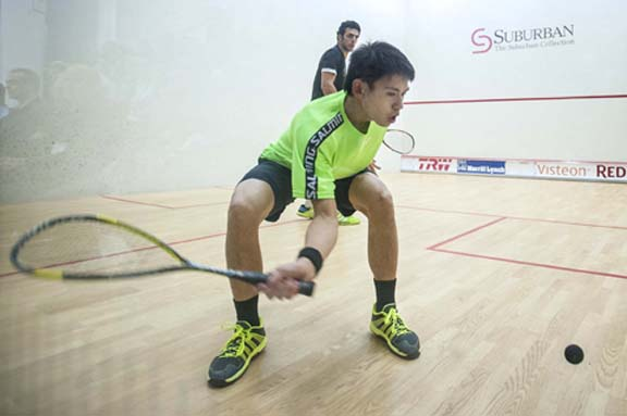 Max Lee gets down low for this forehand against Omar Mosaad. Pictures by BRIAN MITCHELL