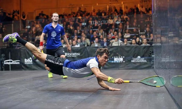 Miguel Angel Rodriguez dives across the court against Gregory Gaultier