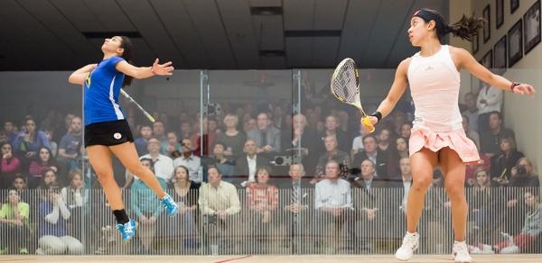 Raneem El Welily jumps off the floor to volley against Nicol David