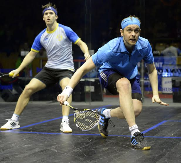 James Willstrop (right) works the backhand line against Chris Simpson