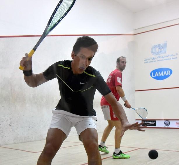 Mazen Hesham in action against Simon Rosner