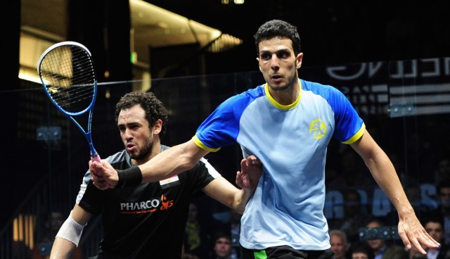 Ramy Ashour winces as Omar Mosaad controls the middle of the court
