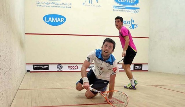 Daryl Selby dives to get the ball back against Miguel Rodriguez