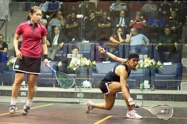 Annie Au in action against Nicol David