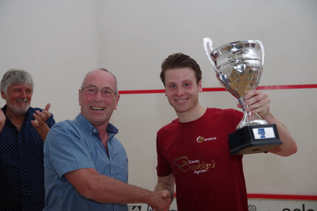 Charles Sharpes receives his trophy from John Powell of Select Gaming