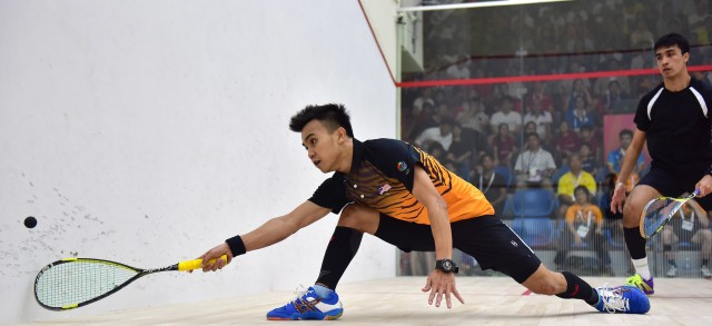 Going for gold:  Malaysia's Sanjay Singh Chal in action against Malaysia's Muhd A Bahtiar Picture: Action Images via Reuters