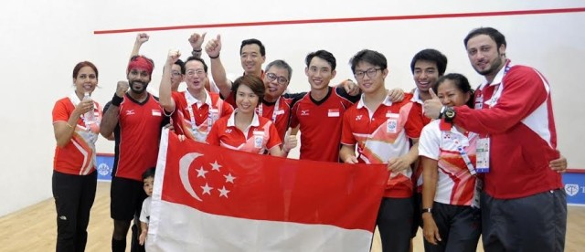The medalists pose for a picture with Singapore chef-de-mission Nicholas Fang (front left) and parliamentary secretary Low Yen Ling