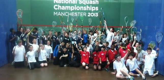 Happy squash kids on court in Manchester