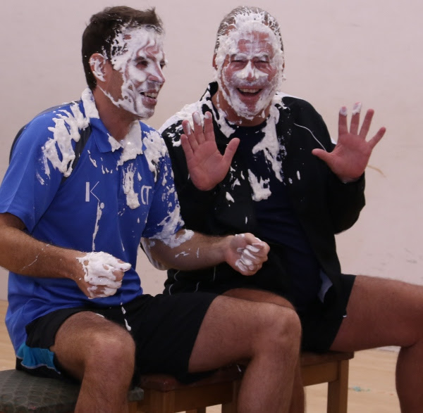 Chris Tomlinson (left) and Alan Thatcher get cream pied by their juniors!