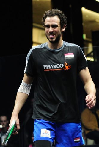 Ramy plays squash with a smile on his face