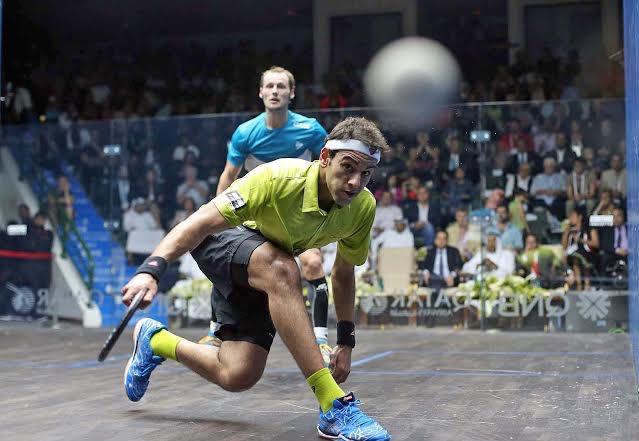 Mohamed Elshorbagy gets in front of Gregory Gaultier