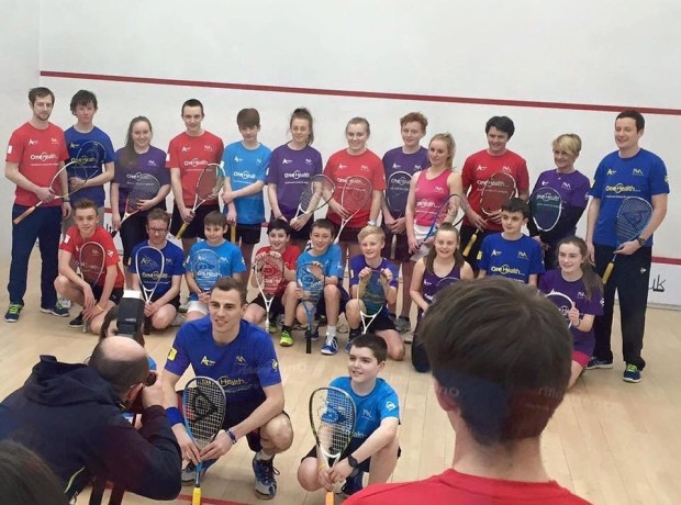 Nick Matthew surrounded by juniors at the launch of his academy