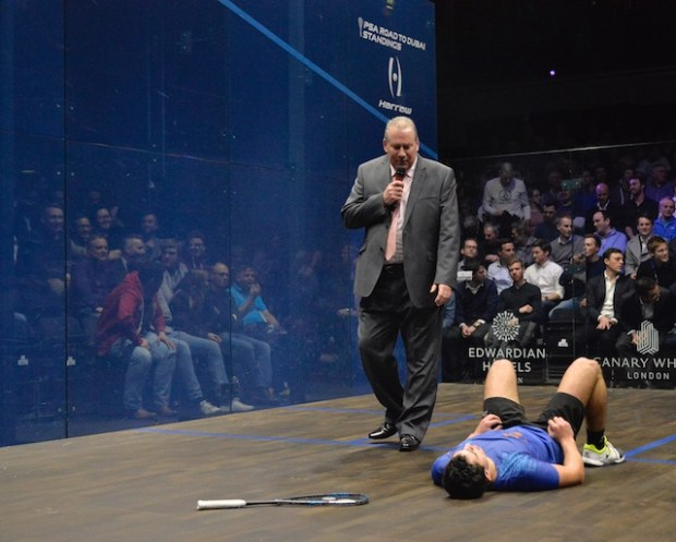 Fares Dessouki lies on the floor in tears after his win over Marwan Elshorbagy
