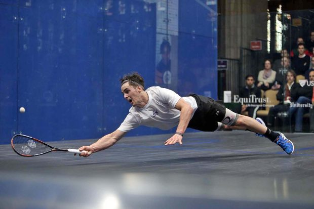 Paul Coll dives across the court in Chicago