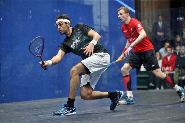 Mohamed Elshorbagy drives against Nick Matthew