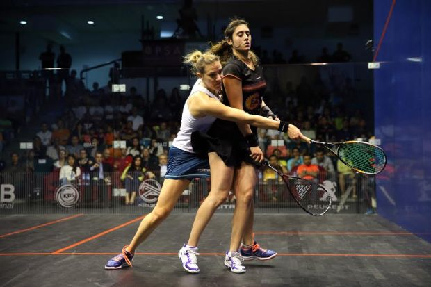 Laura Massaro attempts to find a way to the ball against Nour El Sherbini