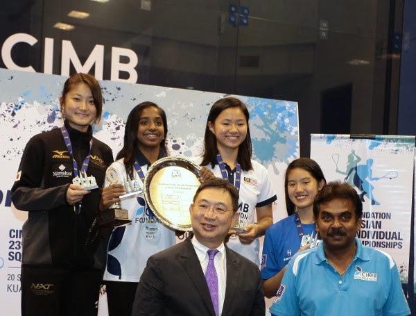 The female medal winners line up in KL