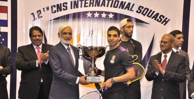 Zahed Mohamed receives his trophy as Jahangir Khan (left) looks on