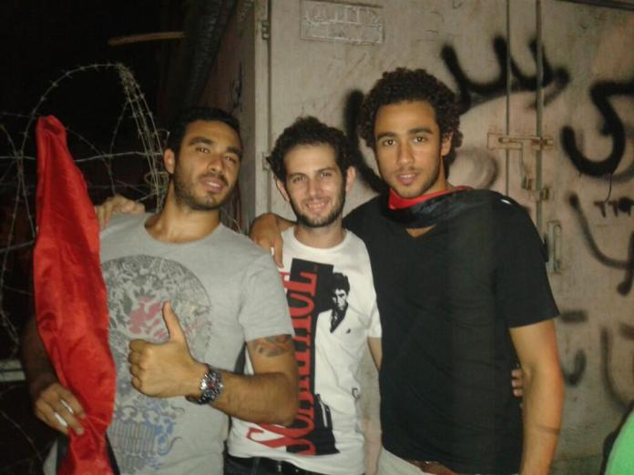 Ramy Ashour (right) protesting in Tahrir Square