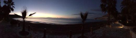 Sun begins to rise across the beach