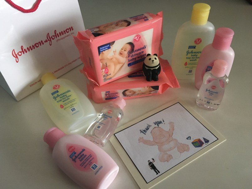J&J goodies: wipes, baby oil, body wash, and lotion.