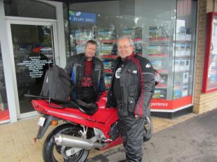 Jeff & Marcos seek shelter from the rain at Broadford, en route to Yea.