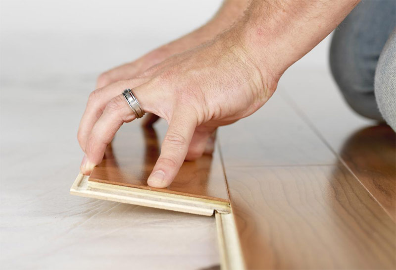 Laying of laminate with fist