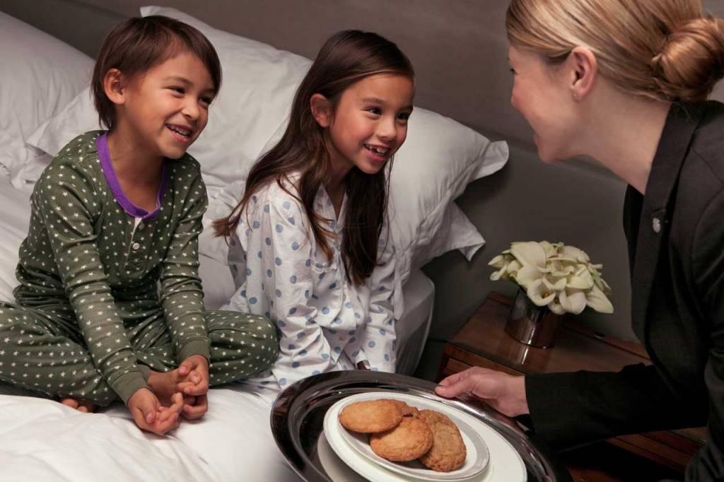 Butler Serving Cookies to Children