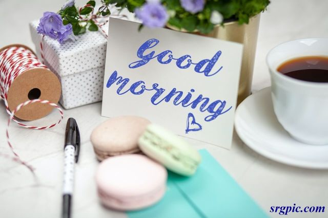 filled-teacup-with-saucer-beside-good-morning-card-and-pen
