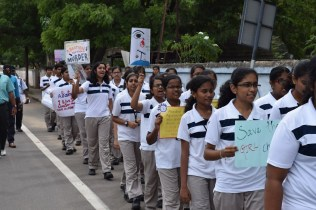 Grade 9 students, with posters