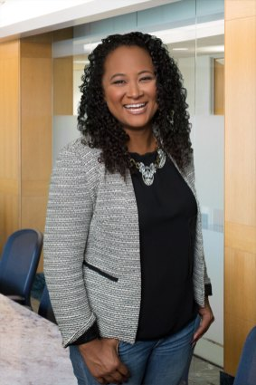 Location Portrait of smiling business woman in blazer and blue jeans