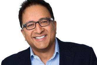 Headshot of smiling man with glasses