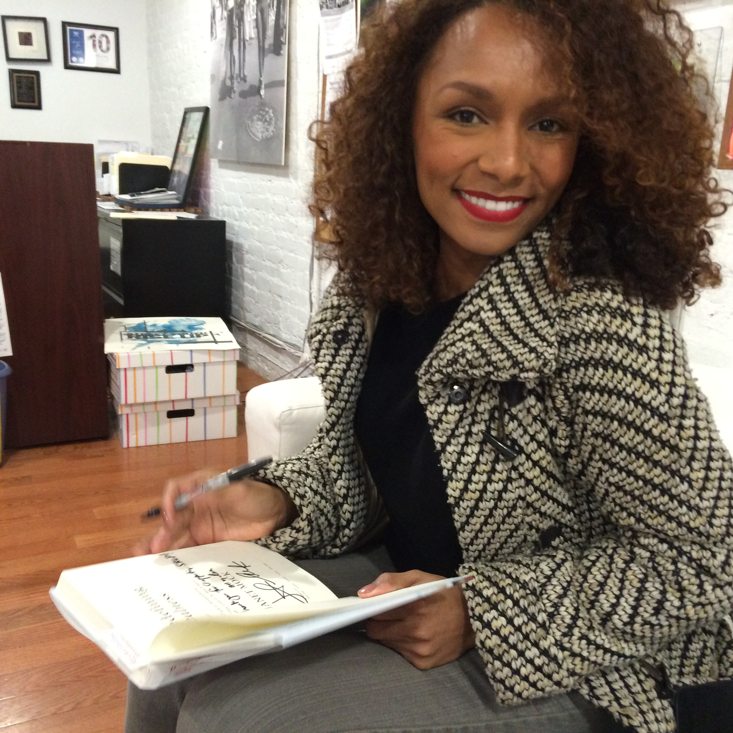 Janet Mock signing Redefining Realness for SRLP's Small Works For Big Change