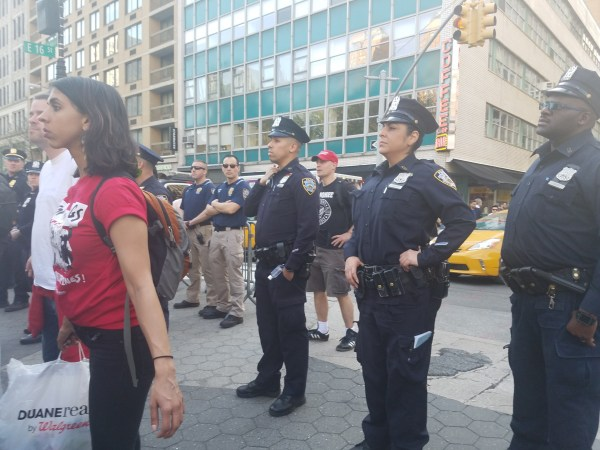 Photo of police officers at a May Day rally.