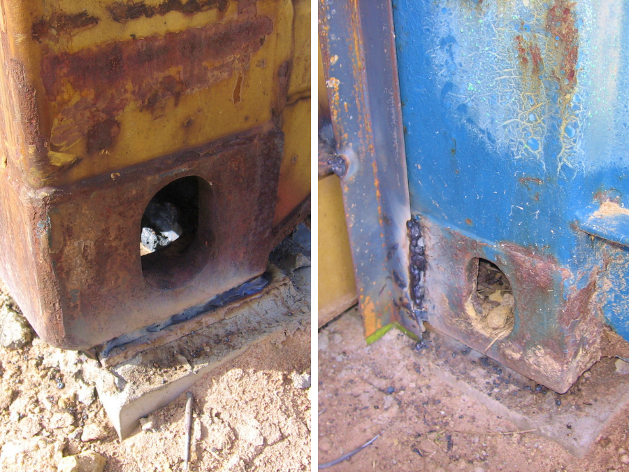 corner castings of shipping containers secured to the ground by welds