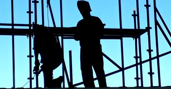 silhouette of welding framing on shipping container house project