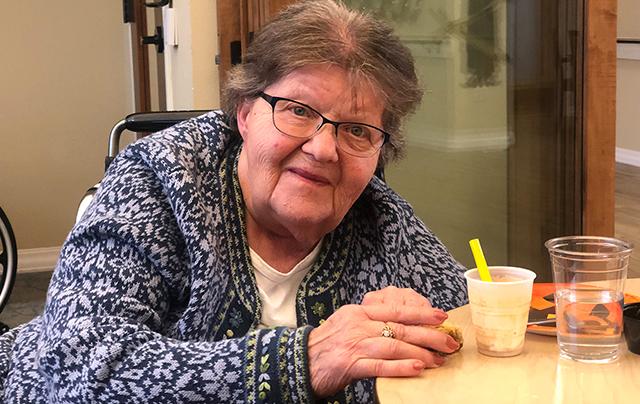 Resident enjoying food at SSC nursing home