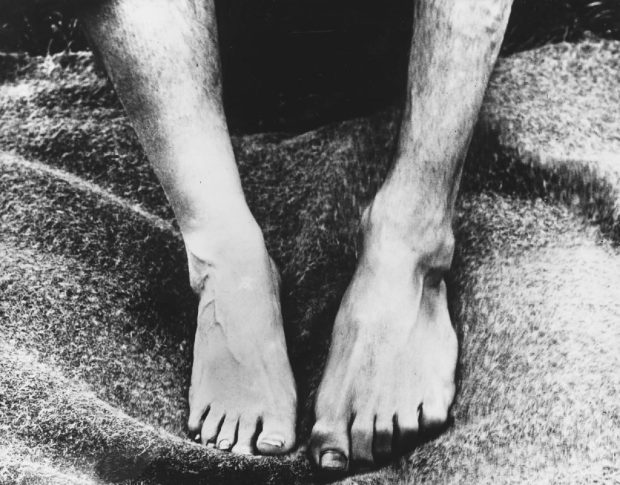 Glass plate negative documenting the variances between the feet of an islander (right) and someone from the mainland (left)