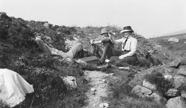Glass plate negative of picnicking on Arran