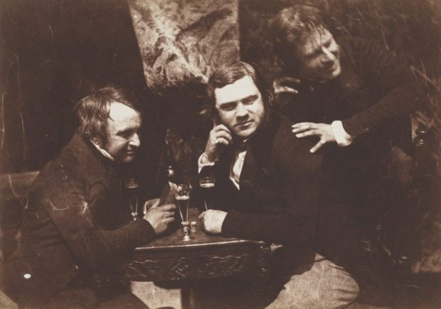 Three men including James Ballantine, Dr George Bell and David Octavius Hil enjoying a drink