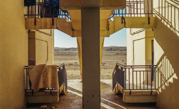 A view out to the desert from behind stairs