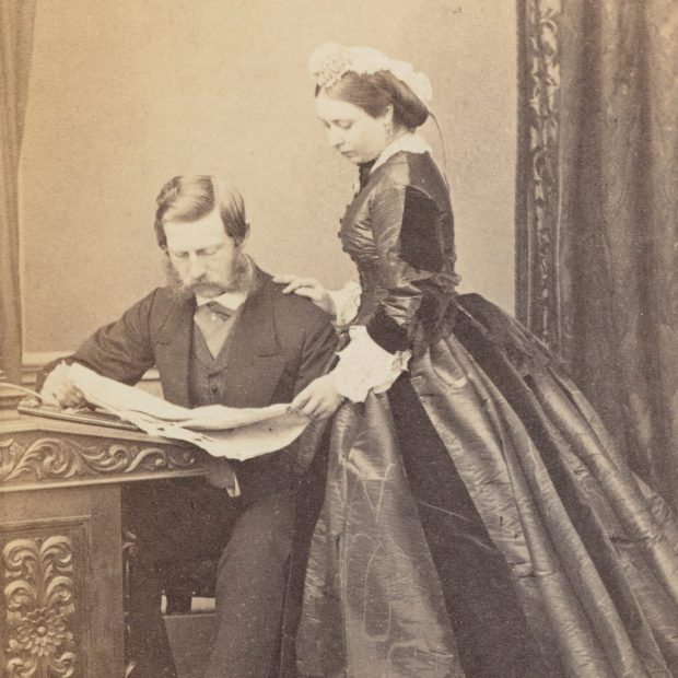 A carte de visite showing a yound Prince Albert seated while Queen Victoria reads over his shoulder