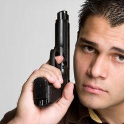 bigstock-Man-Holding-Gun-12035426