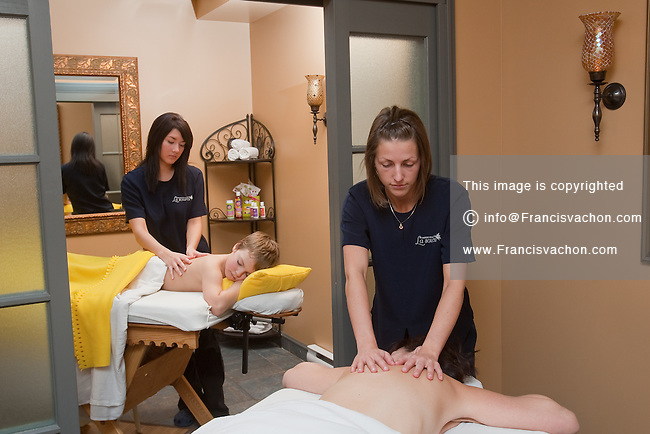 A Mother And Son Receive A Massage Model And Property Release Available