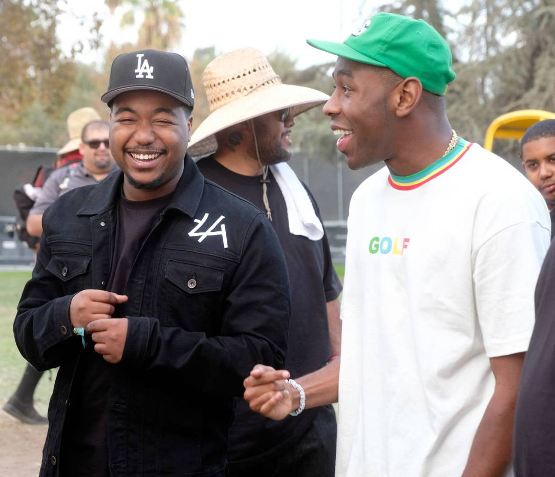 Domo Genesis (L) and Tyler, The Creator are seen backstage during day one of Tyler, the Creator's 5th Annual Camp Flog Gnaw Carnival at Exposition Park on November 12, 2016 in Los Angeles, California.